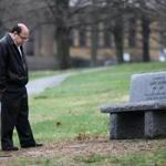 Jim Kasper at a bench memorializing his son at Andover Newton Theological School near his home.